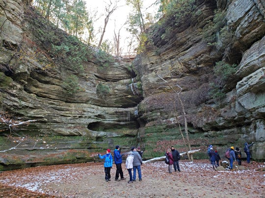 Hikers explore Wildcat Canyon in Starved Rock State Park outside Utica, Illinois.
