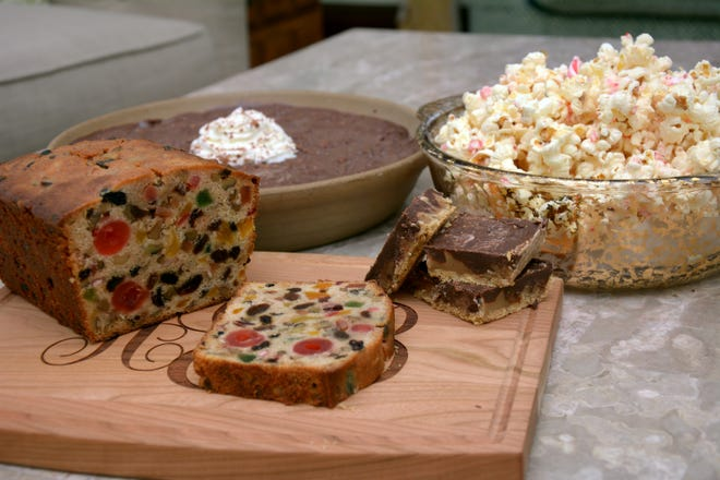 Golden Fruitcake, Chocolate Pecan Pudding Pie, Candy Cane Popcorn and Toffee Bars add up to one sweet holiday dessert spread.