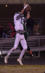 Yellville-Summit's Cody Dobbs attempts to come down with a catch against Danville.