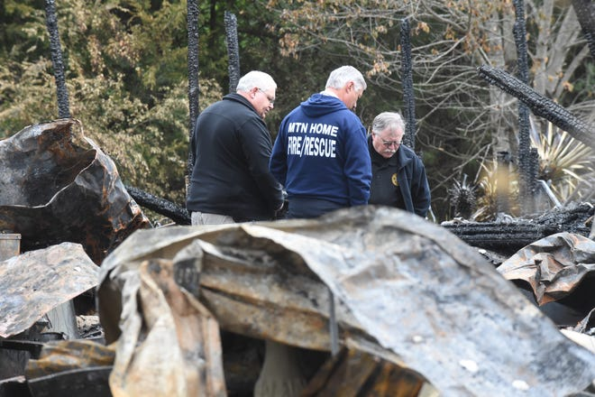 Mountain Home Fire Department Fire Marshall Gary Pyszka, center, is joined by a pair of investigators with the Baxter County Sheriff's Office on Monday as the trio investigate a Friday morning fire that turned out to be fatal.