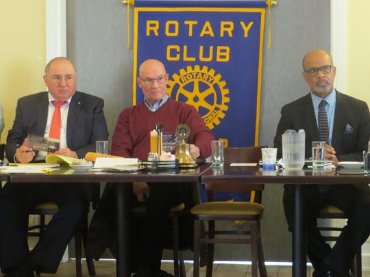 Dover Rotary Club President David Ayers, center, leads a meeting discussion about community efforts to raise funds for Dover fire victims.