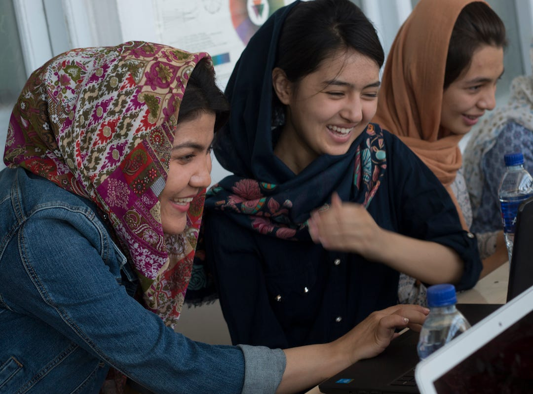 Drew University computer science student Bahara Mohammadi, left, created a program to help women in her native Afghanistan learn how to code.