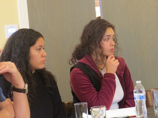 Dover High School seniors Daisy Lopez, left, and Dayanna Valverde  attend a Dover Rotary meeting to discuss student progress in raising funds for Dover fire victims.