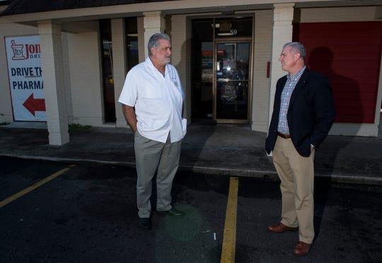 Pharmacist James Jones and developer Lee Willcoxon talk outside Jones Drugs at the Faircourt Shopping Center in Montgomery, Ala., on Monday, Nov. 19, 2018.