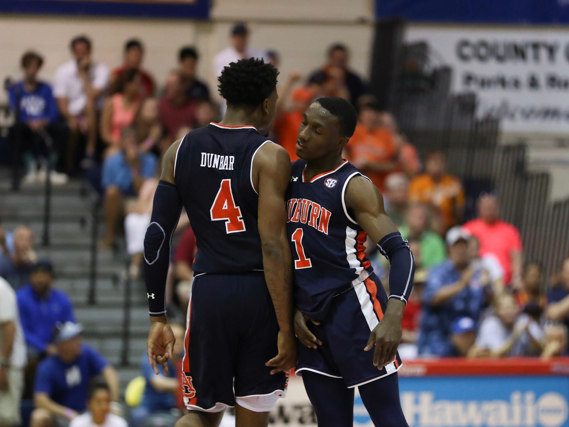 Auburn guard Jared Harper (1) celebrates with forward Malik Dunbar (4) during a game against Xavier in the Maui Invitational on Nov. 19, 2018.