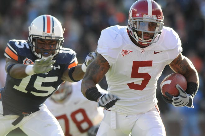 Auburn's Neiko Thorpe (15) pushes Alabama's Roy Upchurch (5) out of bounds during this run in the first half of their game at Jordan Hare Stadium in Auburn, AL. on Saturday, Nov. 27, 2009. (Montgomery Advertiser, Lloyd Gallman)