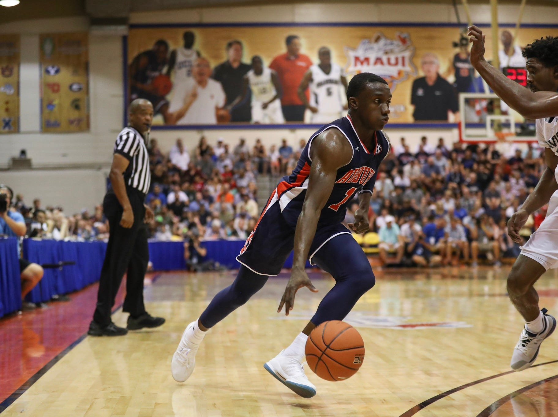 Auburn guard Jared Harper drives to the basket against Xavier during the Maui Invitational on Nov. 19, 2018.
