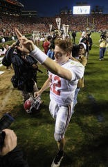 Alabama quarterback Greg McElroy (12) walks off the field following Alabama's victory over Auburn at the Iron Bowl in Auburn, Ala. on Friday November 27, 2009.(Montgomery Advertiser, Mickey Welsh)