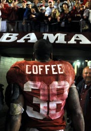 Alabama running back Glen Coffee walks off the field after an exceptional performance against Auburn in the Iron Bowl Saturday, Nov. 29, 2008. (Montgomery Advertiser, David Bundy)