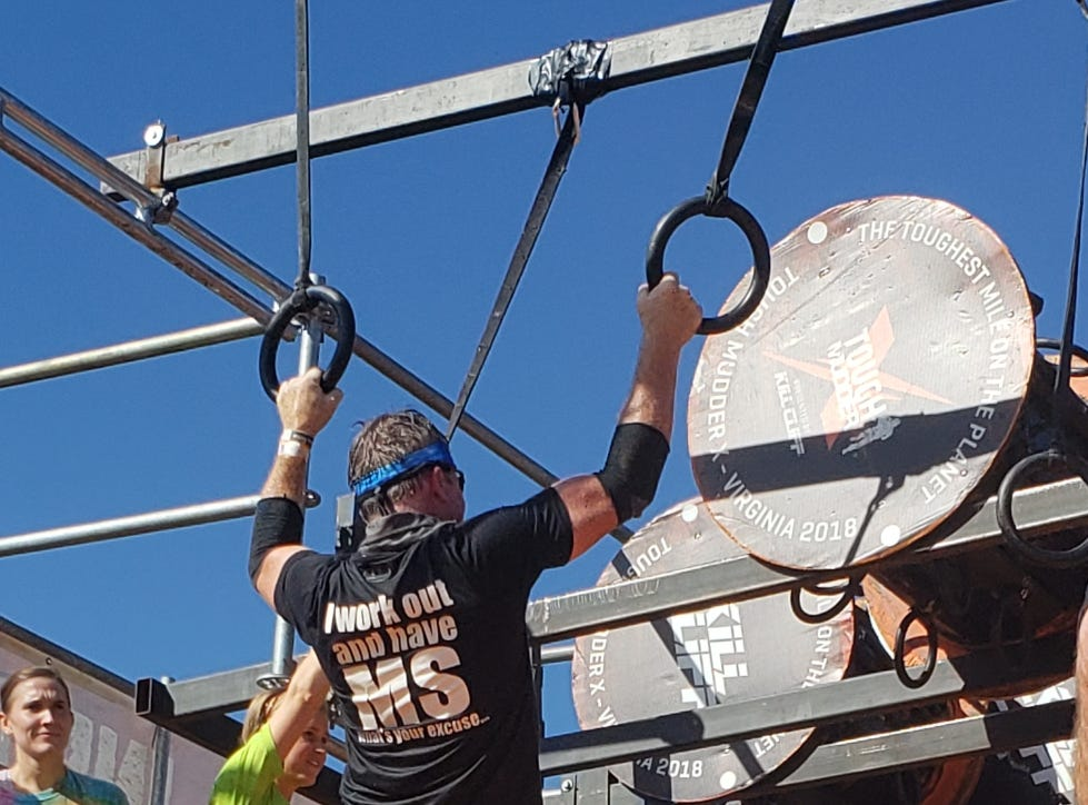 Although his hands hurt, Bruce Ippel of Smyrna pushed himself to compete in a Tough Mudder obstacle course.