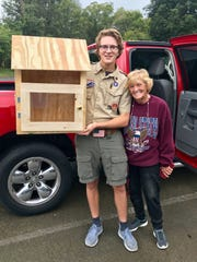 Boy Scout Colin Thompson built nine donation bins for the NOOK nonprofit as his Eagle Scout project. Thompson said he couldn't have completed the project without the carpentry expertise of Myrl Sheradon, a family friend.