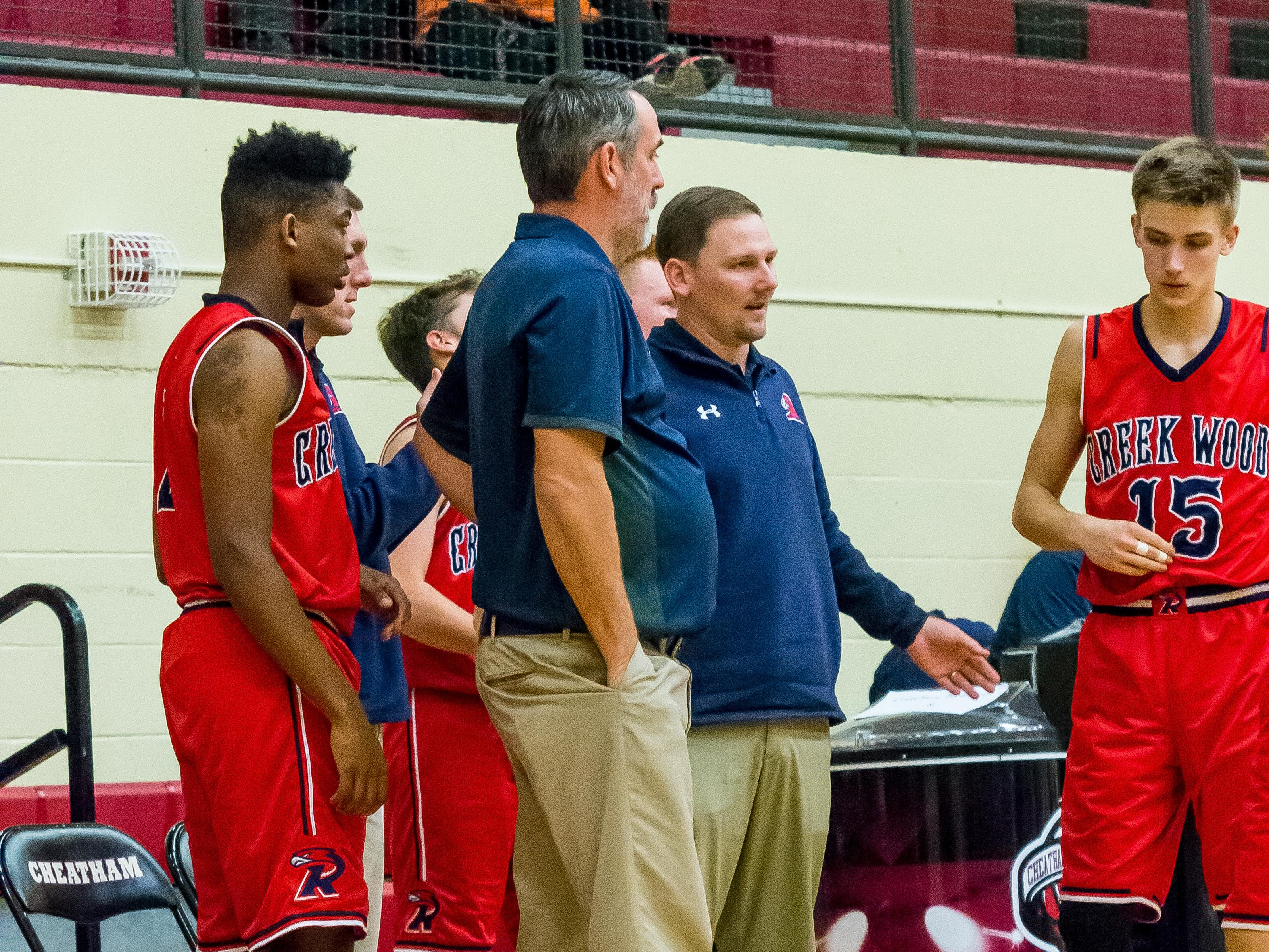 Creek Wood coach Charles Taylor talks to a player during their game with Cheatham County.