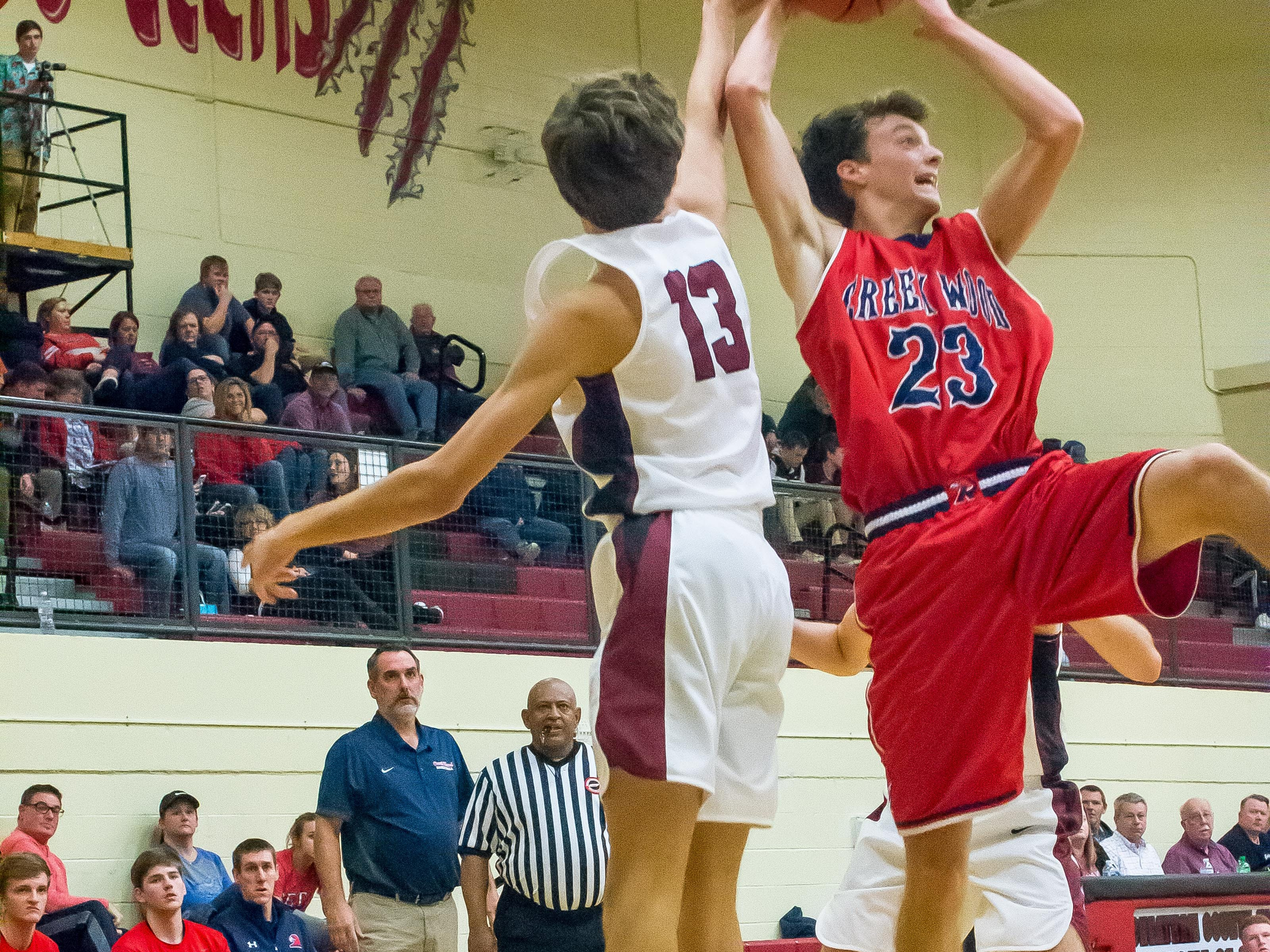 Creek Wood's Tayler Neely grabs a rebound against Cheatham County.