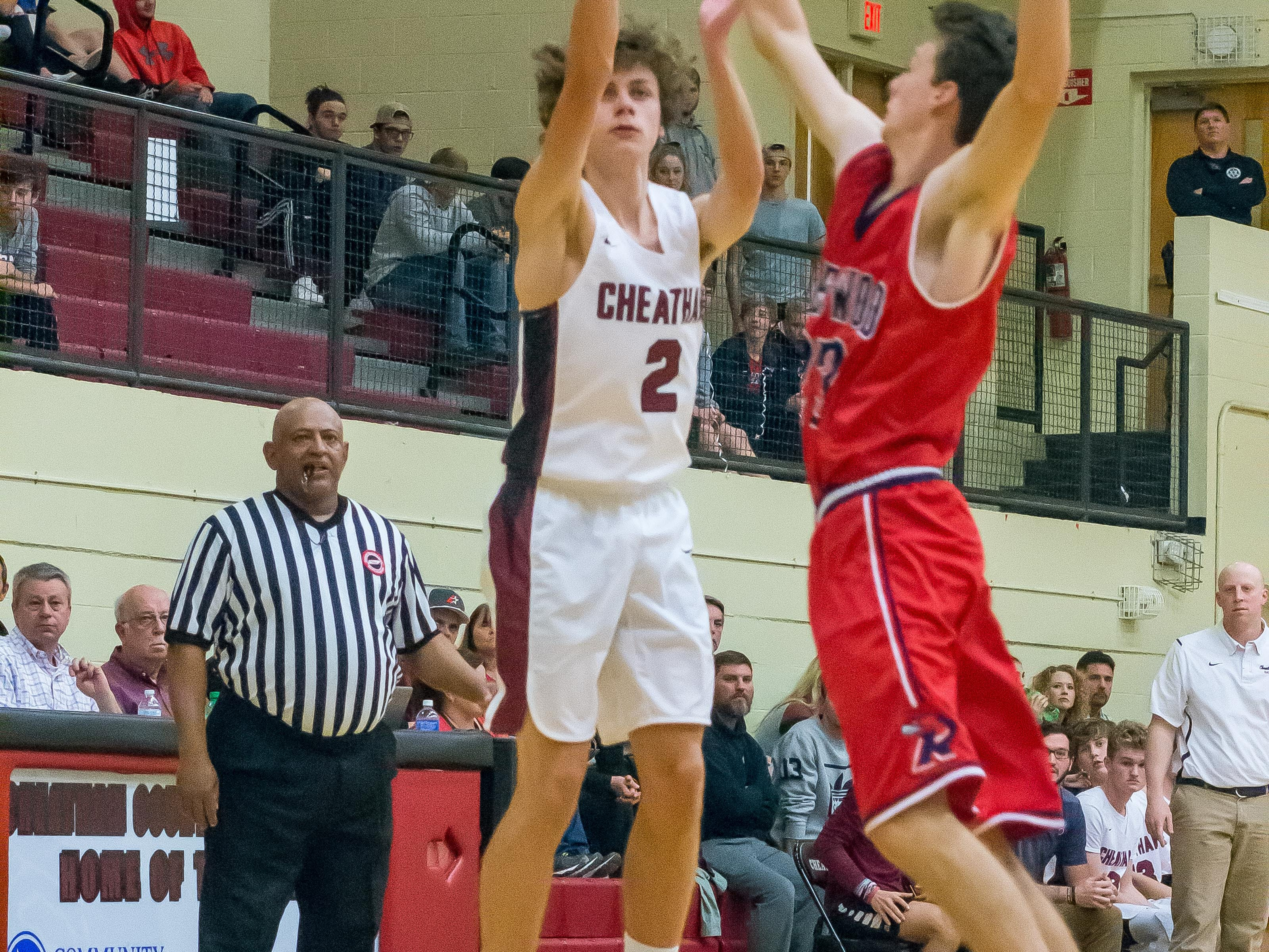 Cheatham County's Robby Morria goes up for a shot against Creek Wood.