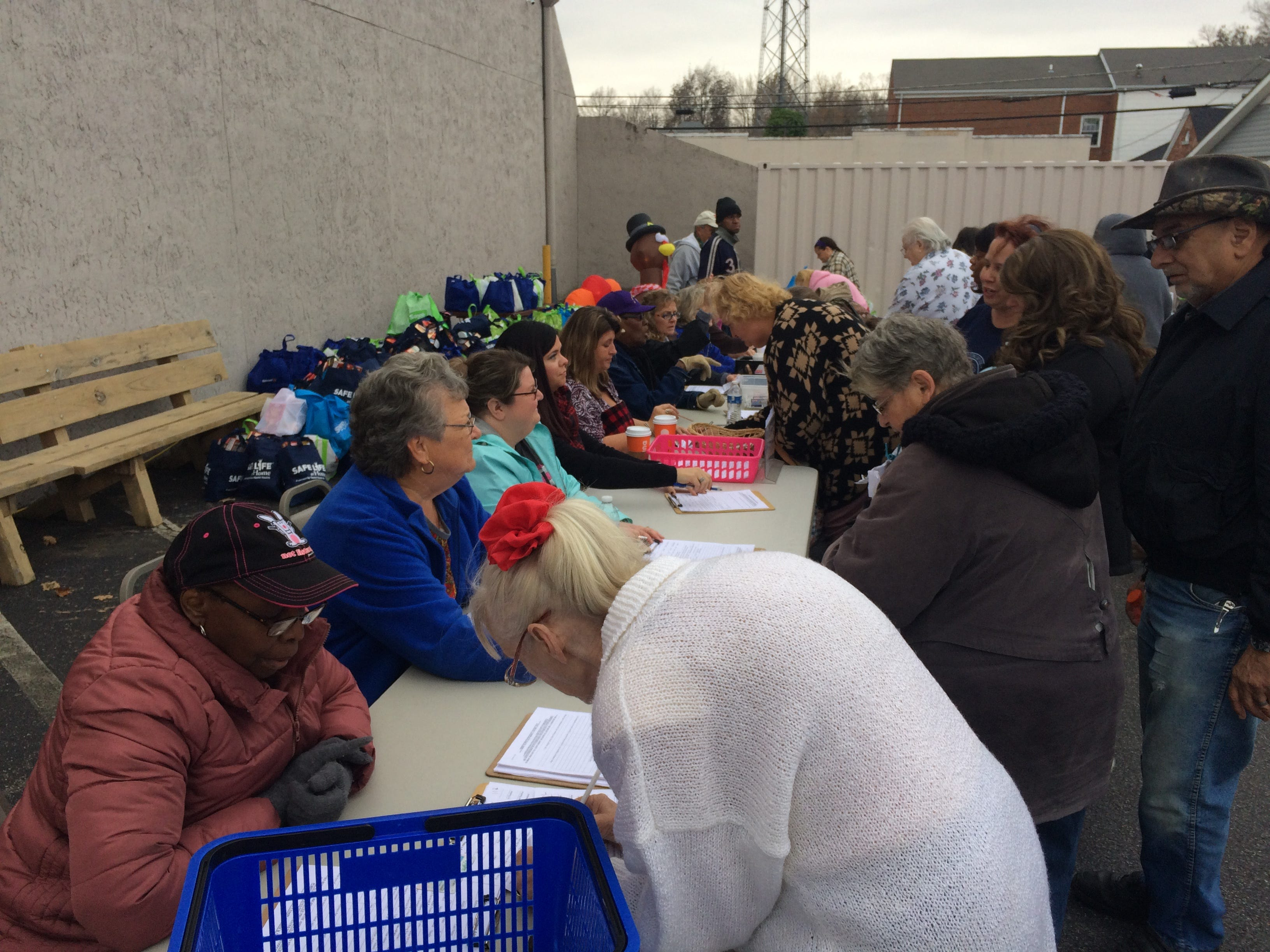 People sign up for a donated turkey and all the fixings at the Dickson County Help Center on Monday morning.