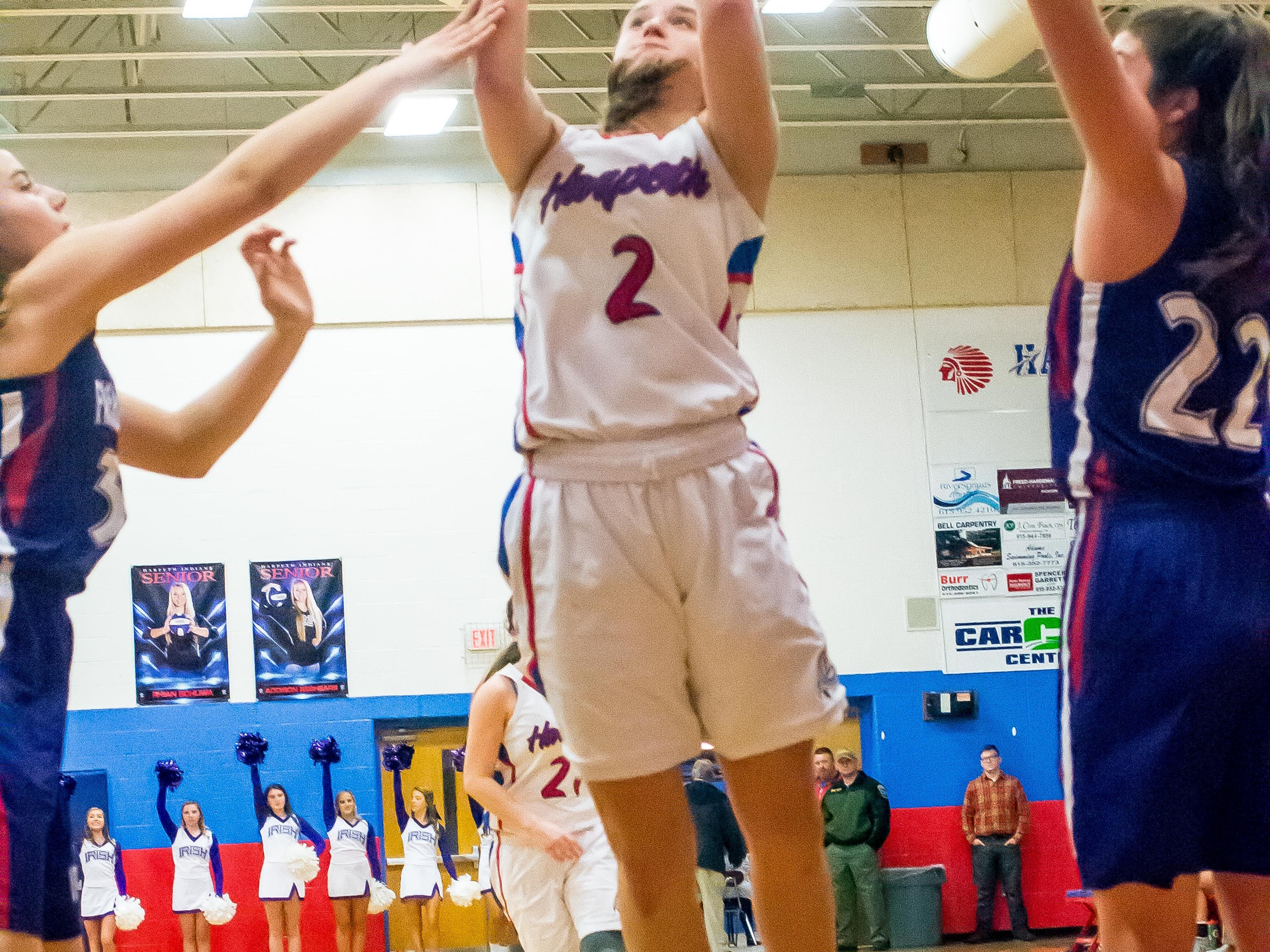 Harpeth's Liza Watson shoots over Father Ryan defender.