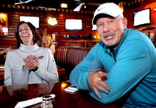 MTSU head football coach Rick Stockstill, right, talks about how he met his wife Sara Stockstill, who laughs at the story in the background, on Monday, Nov. 19, 2018.