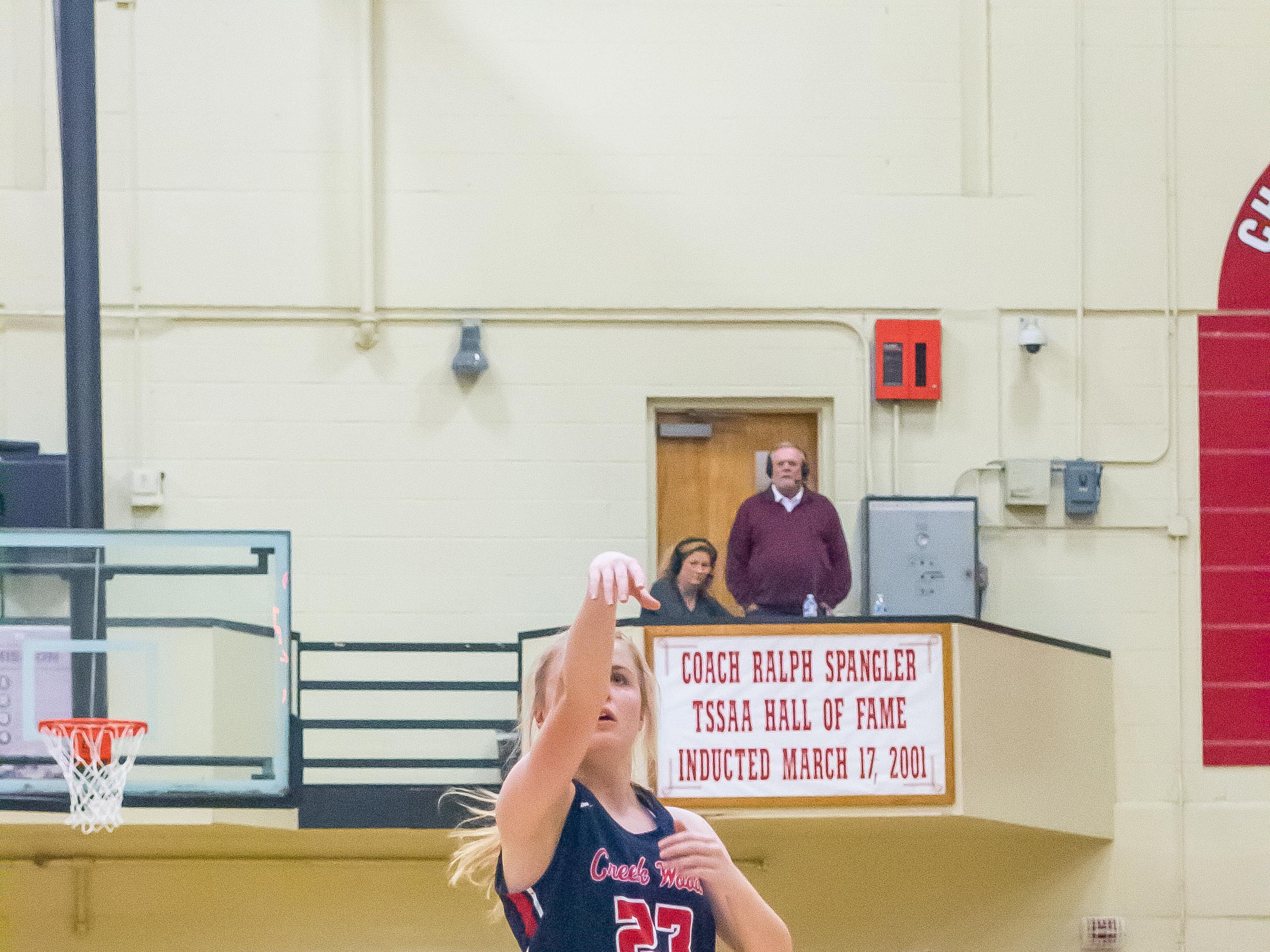 Allie Burgas shoots a free throw for Creek Wood.