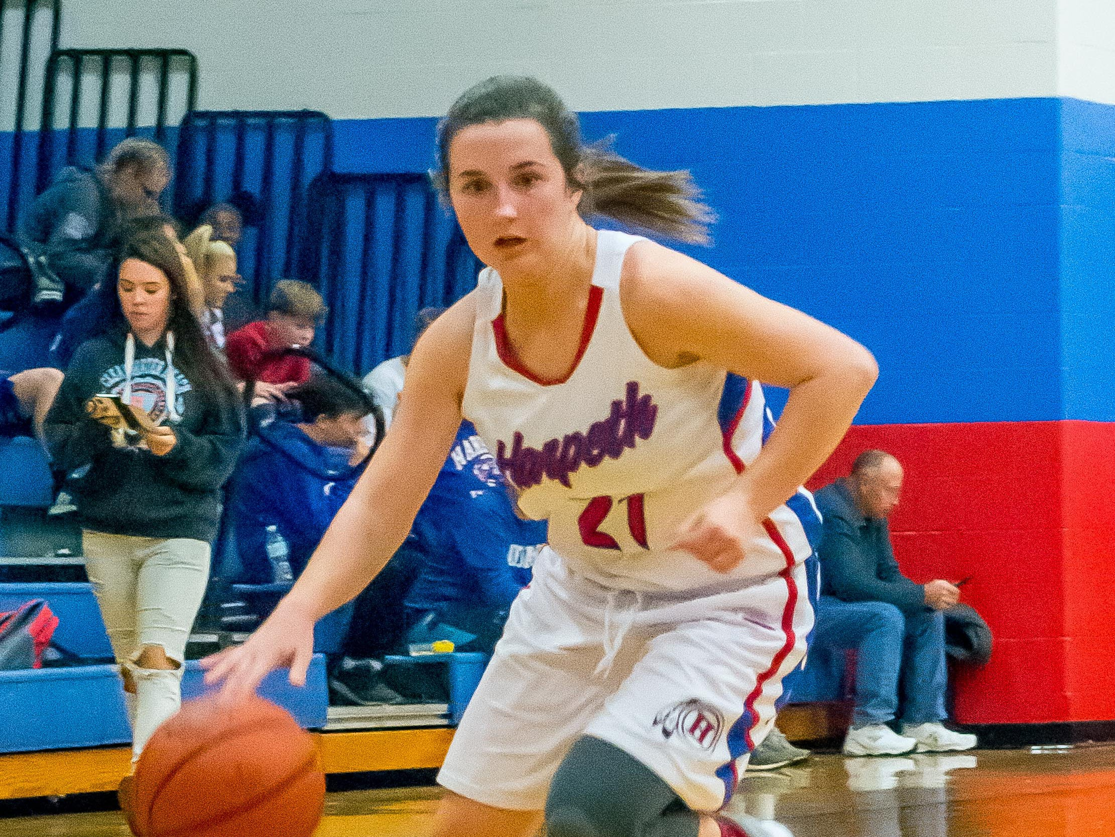 Harpeth's Dani Wix drives toward the basket.