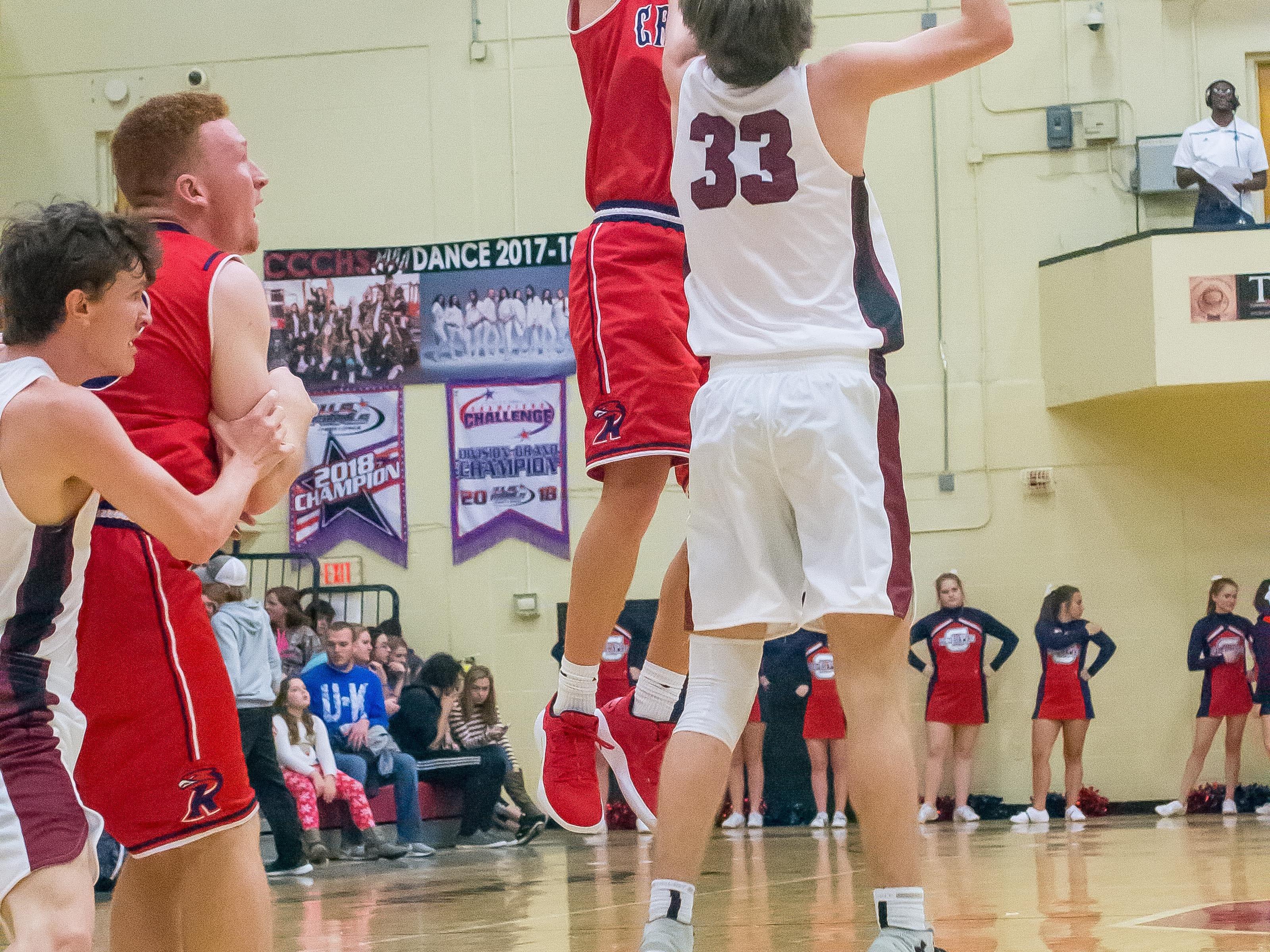 Creek Wood's Tim Randolf shoots a 3-pointer over a Cheatham County defender.