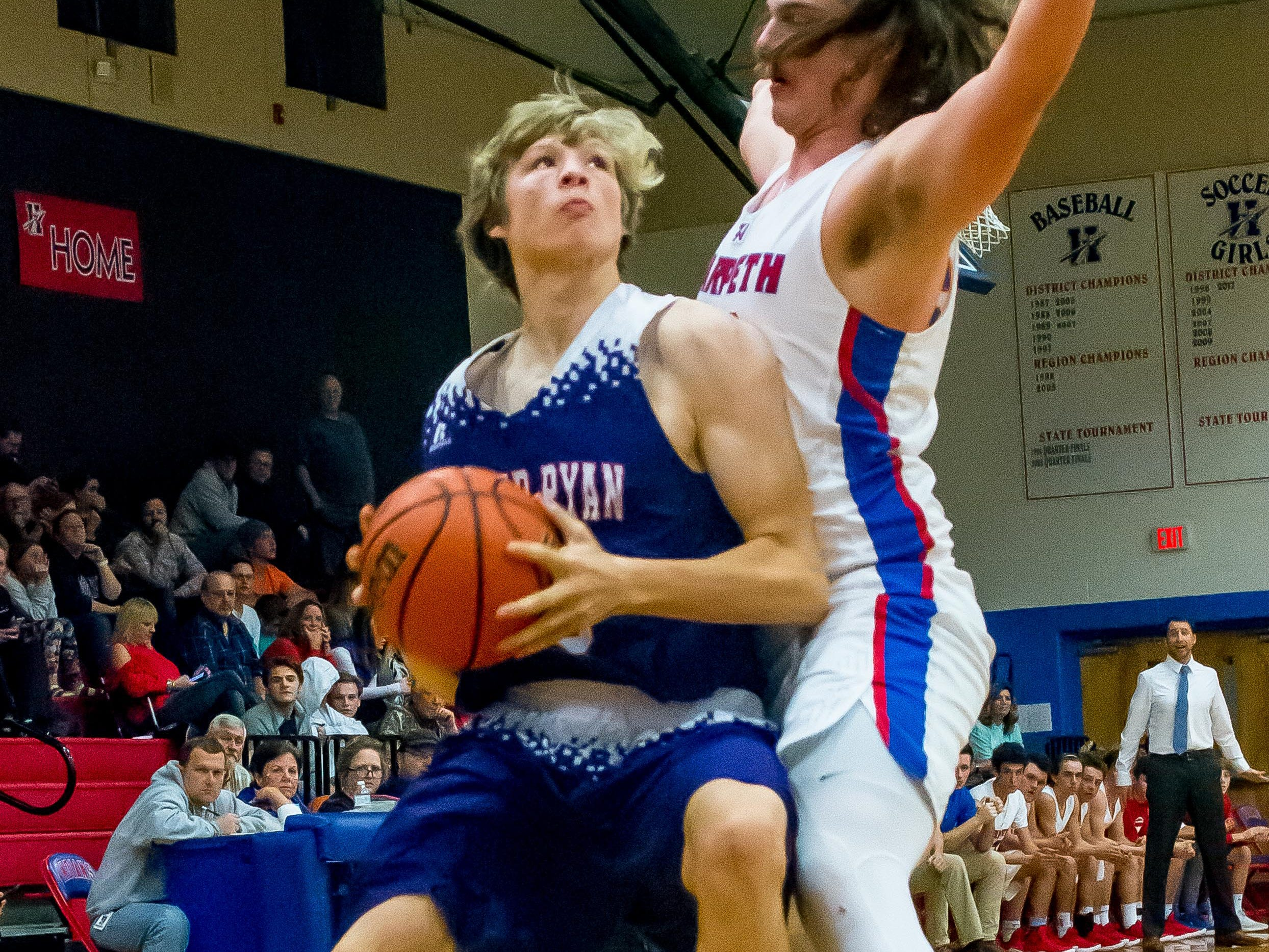 Father Ryan's Sean Clunar goes up for a shot over a Harpeth defender.