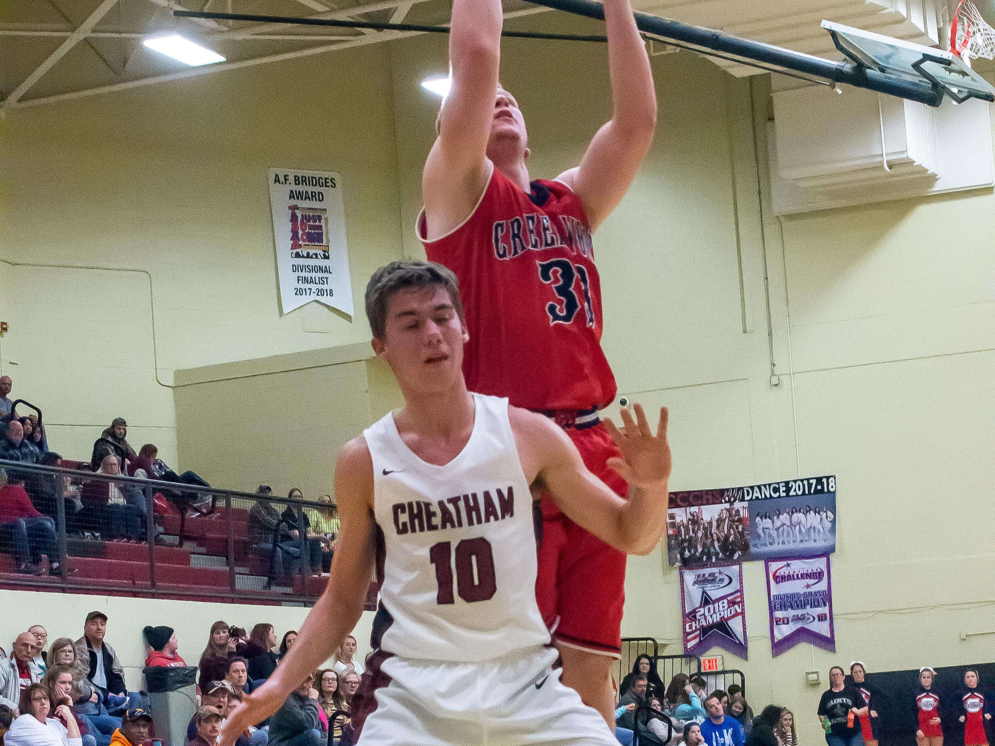 Stone Collins goes over a Cheatham County defender to put up a shot.