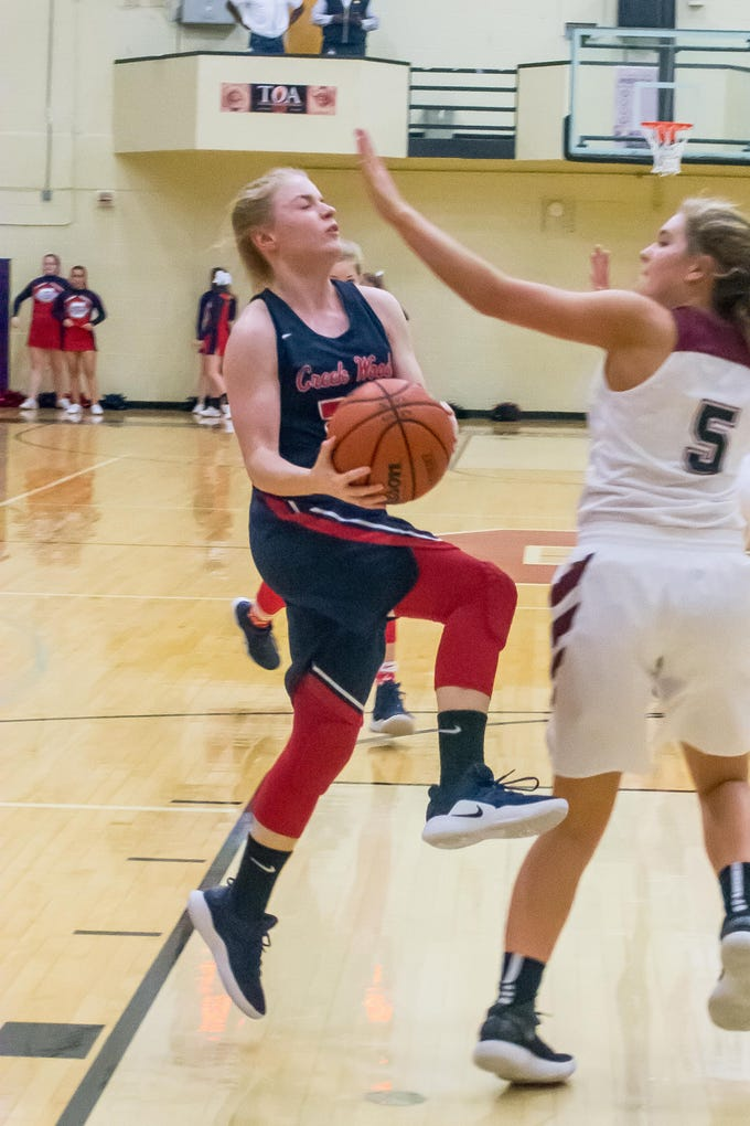 Creek Wood's Allie Burgas with two of her 13 Points against Cheatham County.