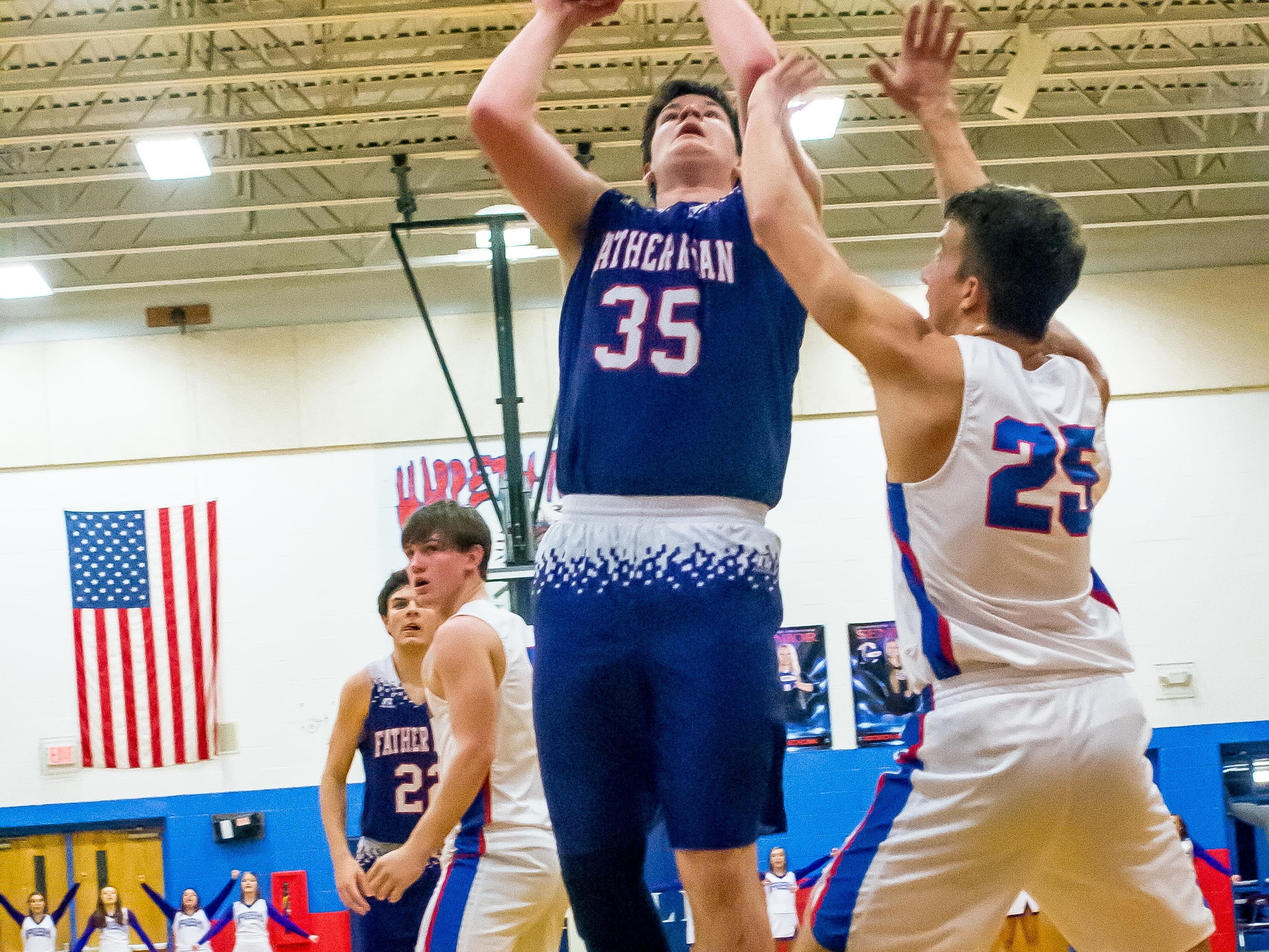 Father Ryan's Forest Smith driving for two points against Harpeth.