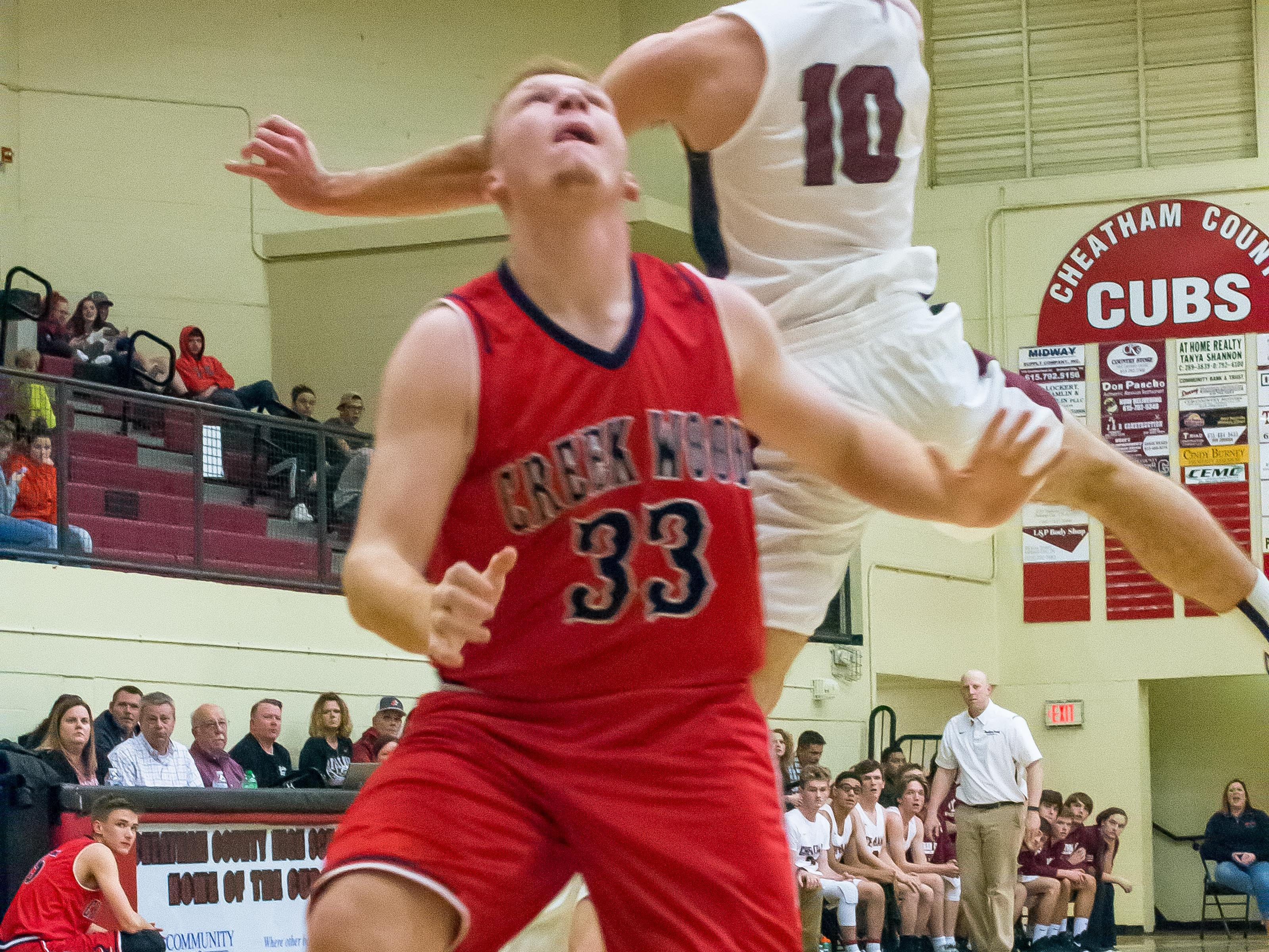Johnathan Mayberry goes up for a shot around a Creek Wood defender.