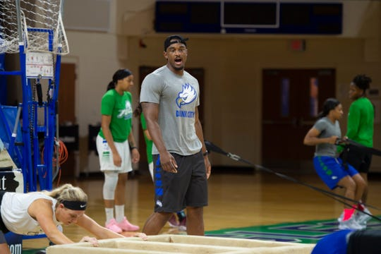 FGCU basketball trainer Travis Wallace works with the women's team