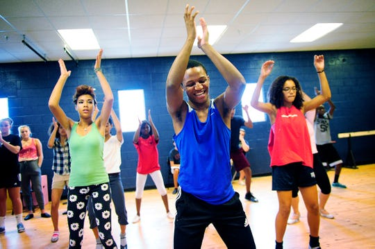 "Chris Campbell, center, runs through a musical dance number during ""Hairspray"" rehearsal July 23, 2014, at Sugden Community Theater in Naples, Fla."