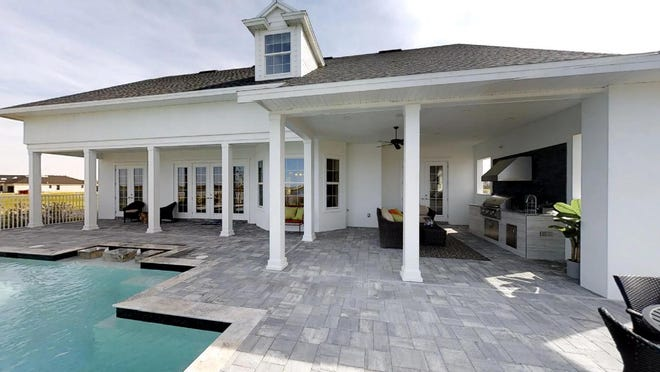 Homebuyers interested in building a custom home with Florida Lifestyle Homes can view the company's craftsmanship in its models, such as the Lauren, shown here.