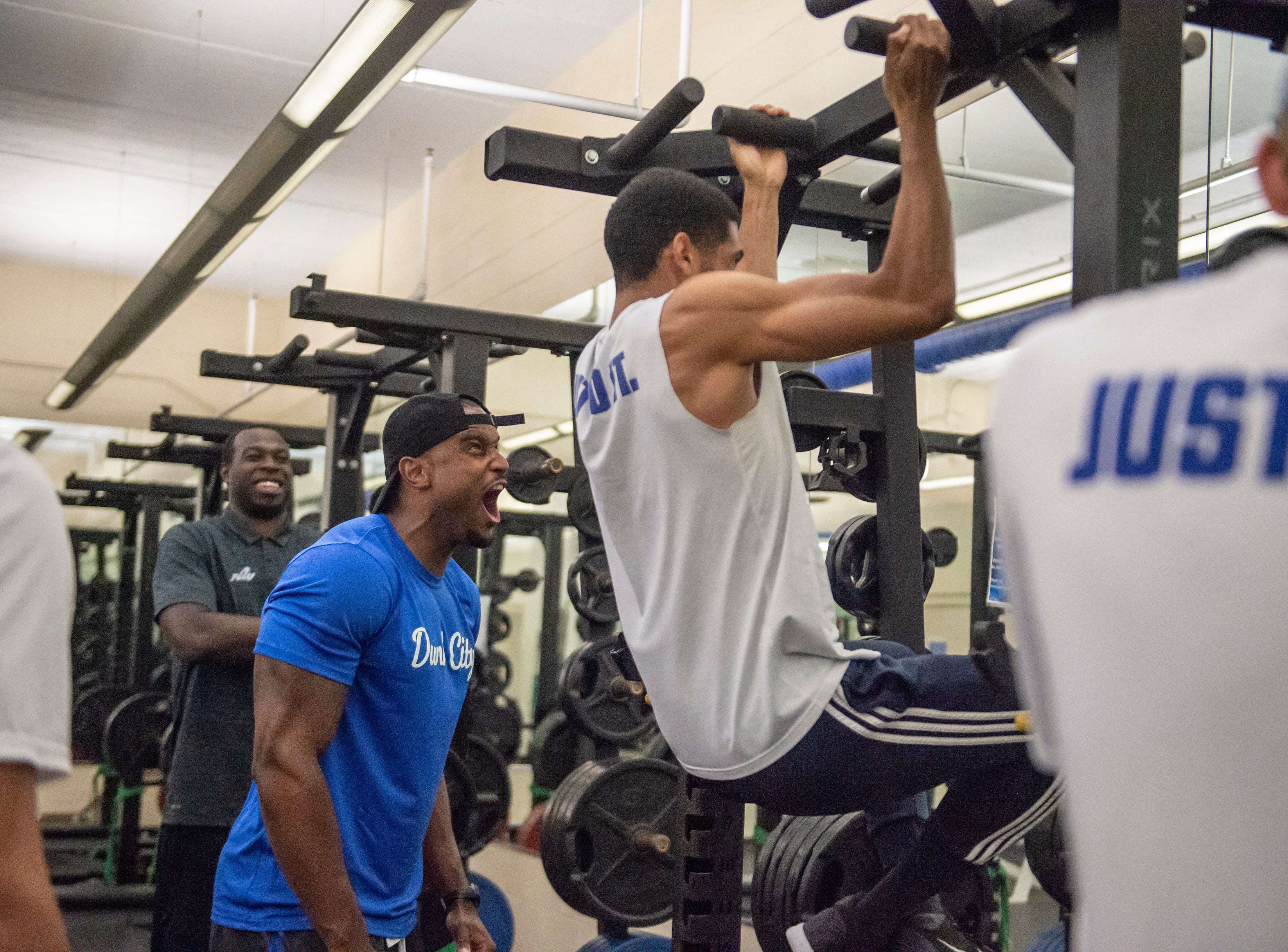 FGCU first-year basketball trainer Travis Wallace motivates Eagles senior guard Dinero Mercurius.