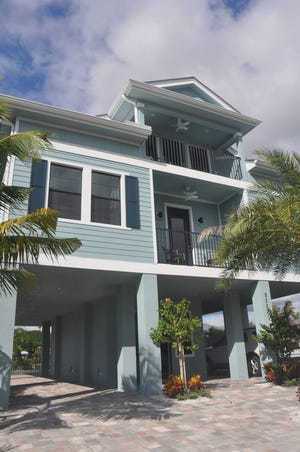 D.R Horton's new Fort Myers Beach home is on a canal across the street from the beach.