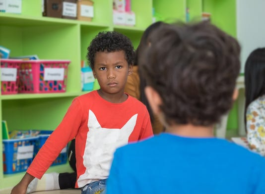 African American Boy Angry And Looking At Friend In School Library In Kindergarten Kids Education Concept