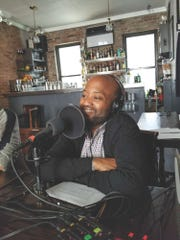 Hall recording his podcast