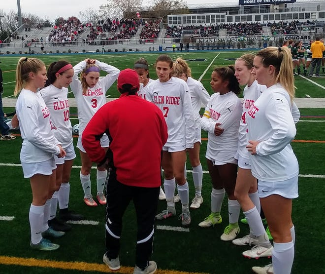 Coach Oscar Viteri meets with his Glen Ridge team during a timeout in the Group 1 final at Kean University.