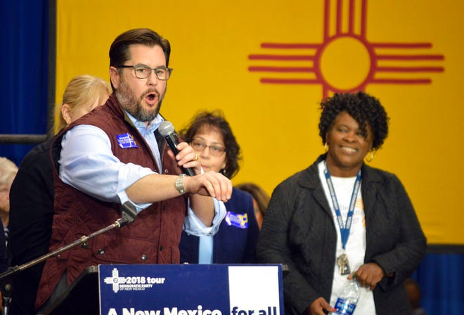 In this Nov. 5, 2018 file photo, Democratic New Mexico House Speaker Brian Egolf, left, speaks at a Democratic rally in Albuquerque on while Democratic House Majority Leader Sheryl Williams Stapleton, right, cheers. Democrats in the New Mexico Legislature are laying plans to ensure legal and safe access to abortion in case regulation of the procedure is returned to states.