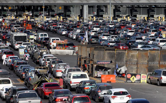 Vehicles line up to enter the United States through the border crossing at Tijuana, Mexico, on Sunday, Nov. 18, 2018. The crossing was closed to northbound traffic for several hours Monday.