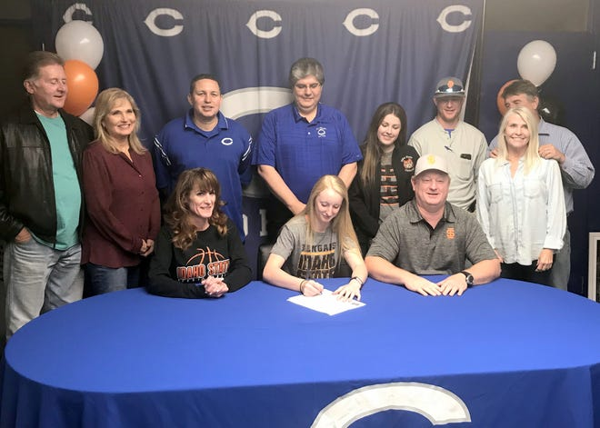 Cavegirl senior Carsyn Boswell signs her letter of intent to attend Idaho State University next season on Nov. 17. Boswell has been a member of the Cavegirls varsity basketball team since her eighth grade year.