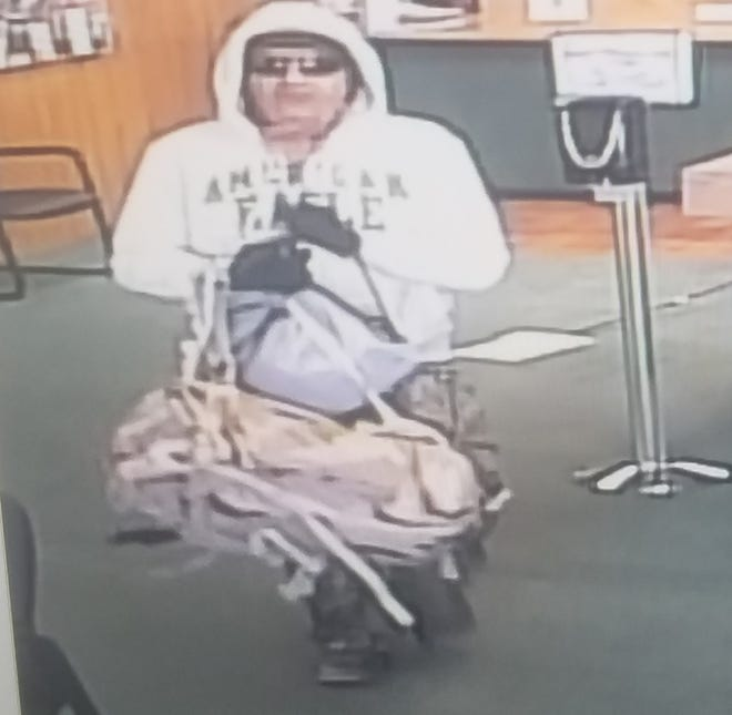 A photo of a suspect robbing the Western Commerce Bank at 501 North Canal in Carlsbad on Friday.