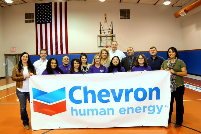 Chevron's Al Davis, Operations Superintendent, presented a check for $30,000 to the Boys & Girls Club of Carlsbad.