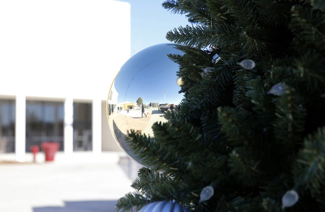 An ornament hangs Monday on a Christmas tree outside the Farmington Civic Center.