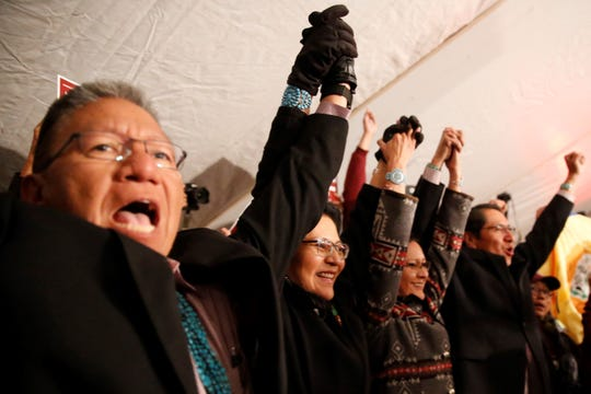 Myron Lizer, left, Dottie Lizer, Phefelia Herbert-Nez and Jonathan Nez celebrate their win in the Navajo Nation presidential and vice presidential election on Nov. 6 in Window Rock, Ariz.