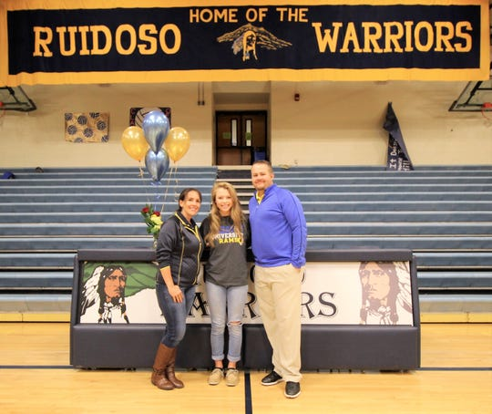 Recipient of a San Angelo State University golf scholarship, Alexandra Michelena and her coaches, Melissa Nanz , girl's golf coach at RHS and Casey Wagner, assistant golf pro at Alto Lakes Country Club celebrate her signing.