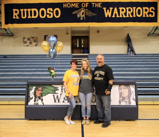 Proud parents (dad and step-mother) of Alexandra Michelena after she accepts a San Angelo State University golf scholarship.