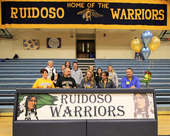 Family, coaches and friends celebrate Ruidoso High school girls golf team member after signing onto San Angelo State University golf team with scholarship.