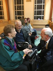 Dr. Patrick Scannon (right) greets 99-year-old Agnes Phillips (left) and Westland's Tom Kozak during the Nov. 10 funeral for U.S. Navy radioman Walter E. Mintus. Phillips, who turns 100 on Dec. 31, and Kozak are MIntus' niece and nephew, respectively. Scannon is founder of the BentProp Project.
