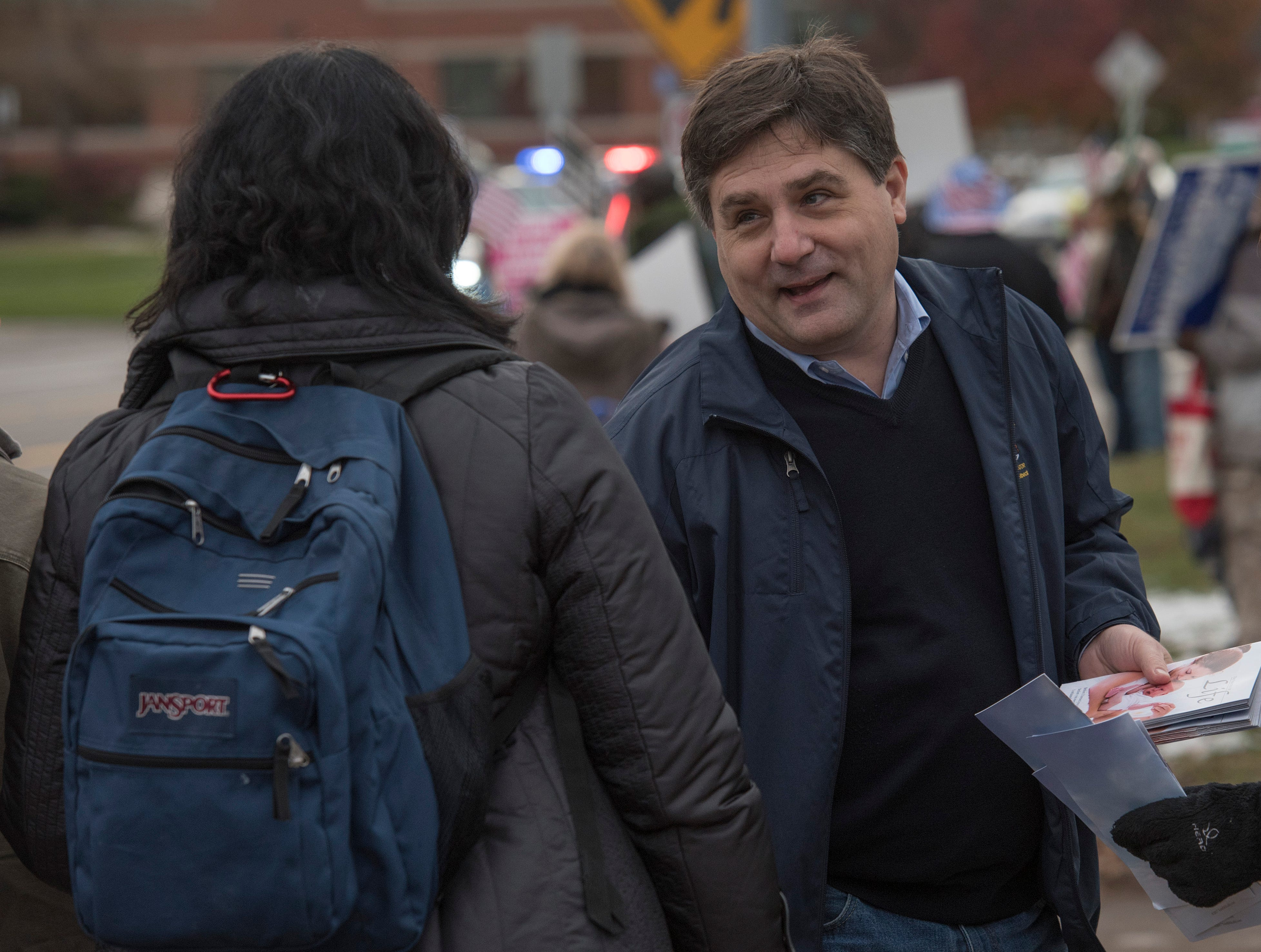 State Senator Patrick Colbeck, of Canton speaks with protesters at the Planned Parenthood facility.