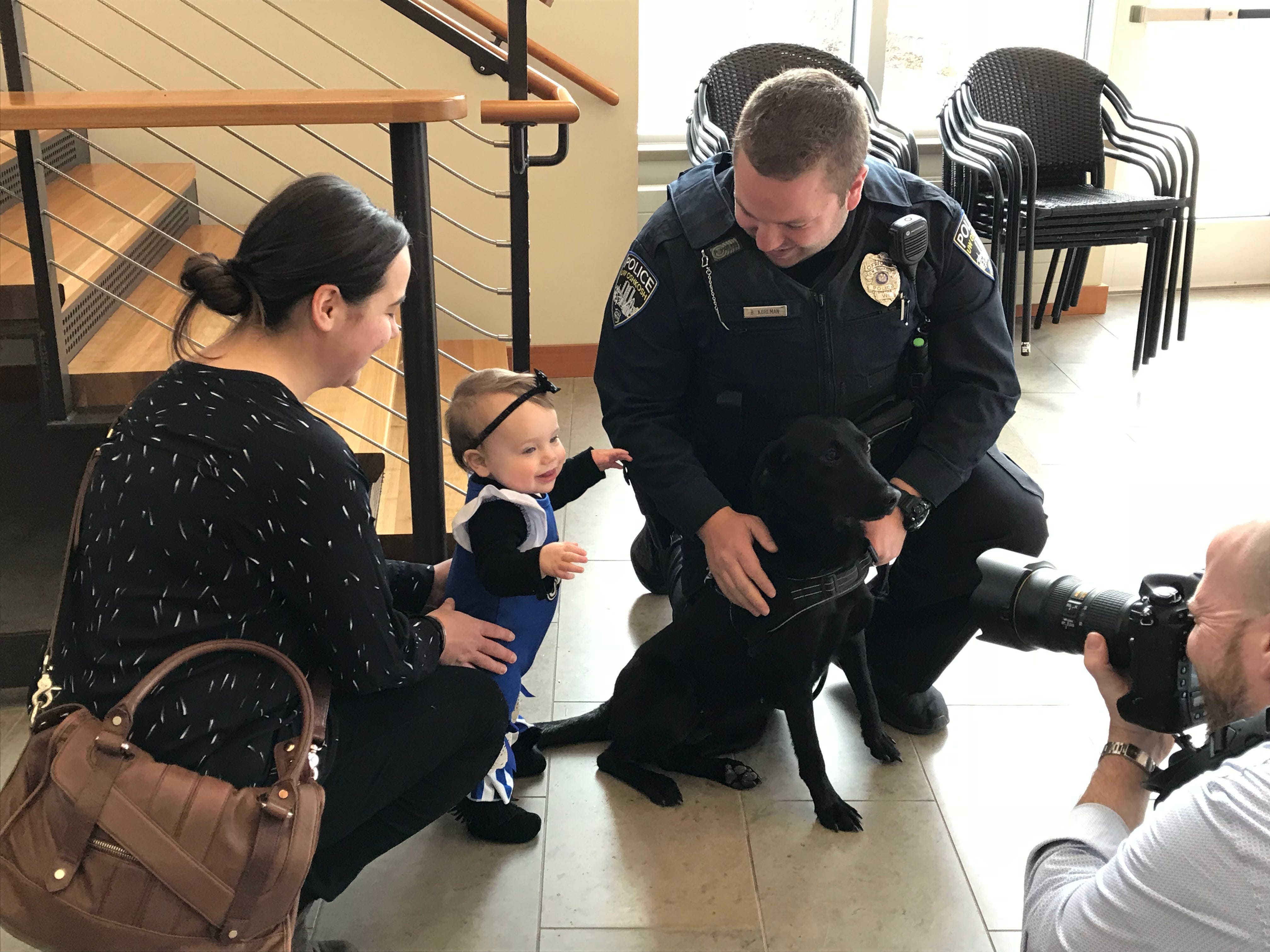 The Kohlman family gets media attention Monday at the University of Wisconsin-Oshkosh as their dog Skylar becomes a K-9 officer.